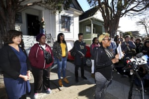 Walker, right, speaks for herself and on behalf of fellow Moms 4 Housing members Sharena Thomas, second from left, Misty Cross, and Tolani King, as the councilwoman Nikki Fortunato Bas, left, looks on during a press conference on 10 January.