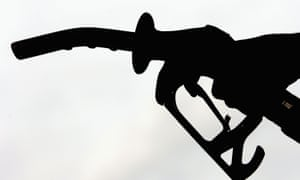 A petrol pump silhouetted