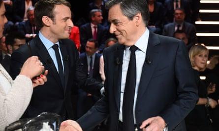 Emmanuel Macron shakes hands with his rival François Fillon