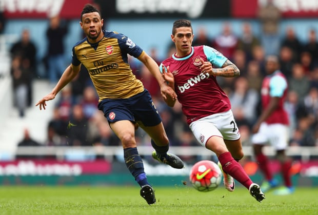 Coquelin attempting to get the better of Lanzini in last seasons clash.