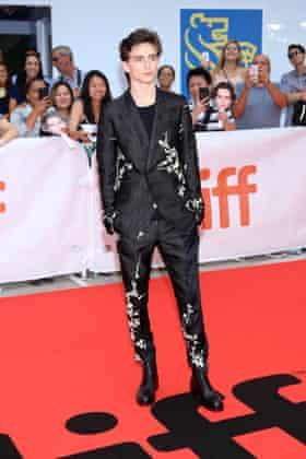 'a mix of rock'n'roll and romance' … Timothée Chalamet in a floral appliquéd Haider Ackermann suit.