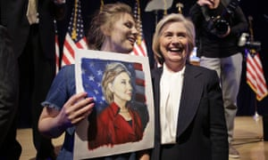 Hillary Clinton poses for a photograph with Chelsea Galinos, 21, left, who painted a picture of the Democratic presidential candidate after her speech in New York on Monday.
