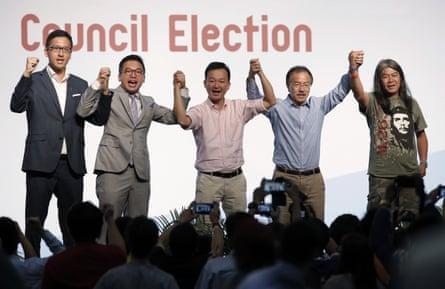Pro-democracy candidates Lam Cheuk-ting, Alvin Yeung Ngok-kiu, Raymond Chan Chi-chuen, Fernando Cheung and Leung Kwok-hung celebrate after winning seats.