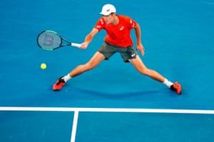 Alex de Minaur flings a forehand to Rafael Nadal.