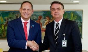 Jair Bolsonaro shakes hands with Miguel Ángel Martín, one of several exiled Venezuelan opposition leaders with whom he held talks in Brasília, Brazil, on 17 January.
