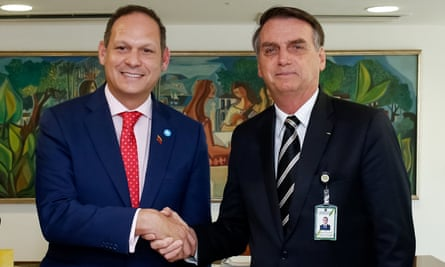 Jair Bolsonaro shakes hands with Miguel Ángel Martín, one of several exiled Venezuelan opposition leaders with whom he held talks in Brasília, Brazil, on 17 January.