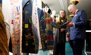 The Prince Of Wales checks out sustainable clothing at the Yoox Net-a-Porter offices, in London, on May 16 2018.