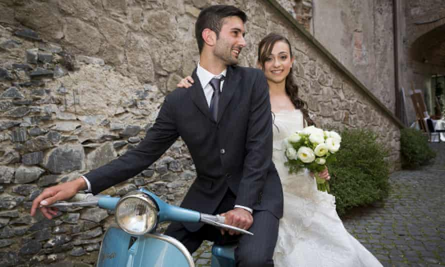 VARIOUSMandatory Credit: Photo by Andrea Matone/imageBROKER/REX Shutterstock (4974817a) MODEL RELEASED Bride and groom on a Vespa moped, Rome, Italy VARIOUS