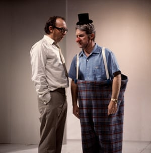 Eric Morecambe with Ernie Wise in a clown costume