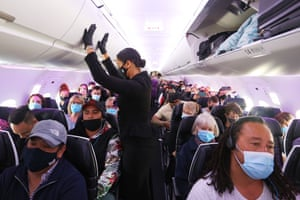 Preparing for takeoff: passengers aboard an Air New Zealand flight from Sydney to Wellington.