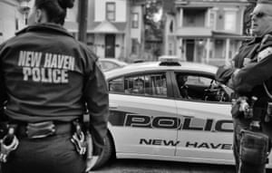 A young man is arrested by New Haven police officers.