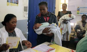 Babies are brought to be vaccinated against measles at a health clinic in Madagascar
