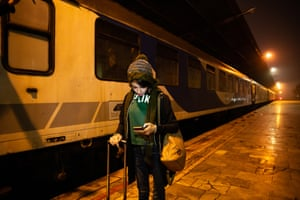 Zeinab at the train station on a long journey to Tehran for a game.