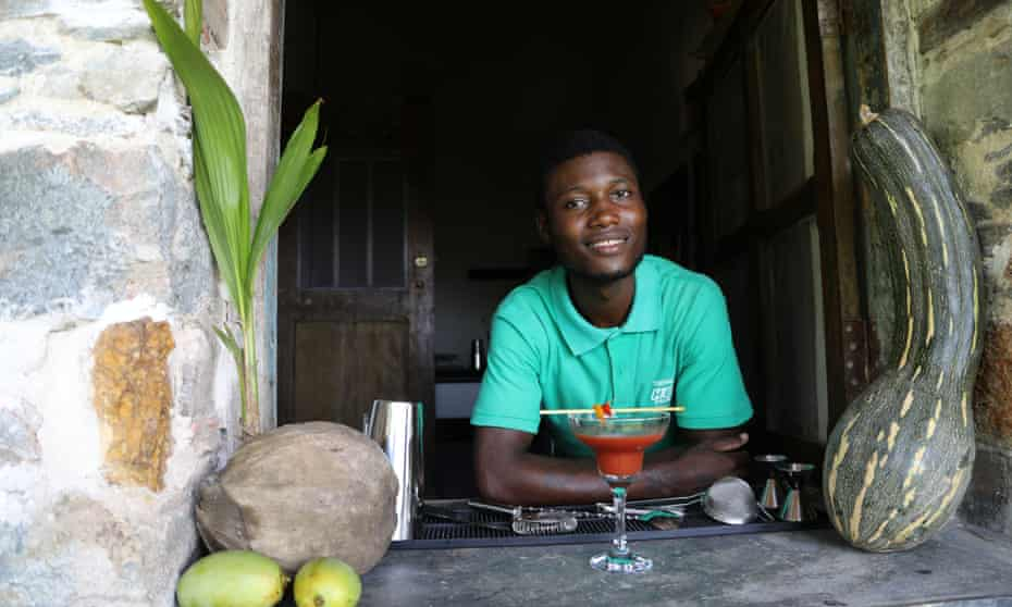 Alexander at Roça Sundy plantation house with one of his cocktails.