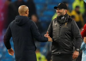 Guardiola shakes hands with Klopp at the end of the match.