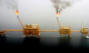 Gas flares from an oil production platform at the Soroush oilfields in the Persian Gulf, south of Tehran.