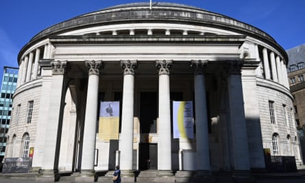 A person walks past a closed Manchester central library during lockdown.