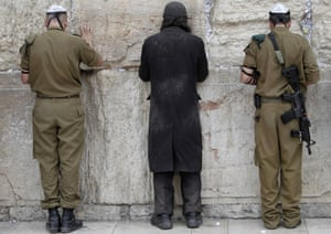 Israeli soldiers and an ultra-Orthodox Jewish man pray at the Western Wall, in Jerusalem's Old City.