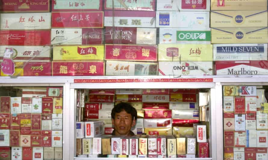 A cigarette vendor at a Beijing stall. Nearly 50% of men in China smoke but just 2% of women.