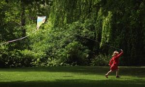 Flying a kite in Greenwich Park flower gardens