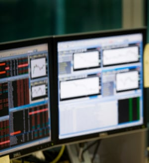 A trader's screens at CMC Markets in London.