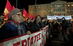 epa04640597 Supporters of the Communist Party of Greece (KKE) protest during a rally in Athens, Greece, 27 February 2015. The protest was aimed against the so-called anti-austerity memorandum between EU and Greece. EPA/ALEXANDROS VLACHOS