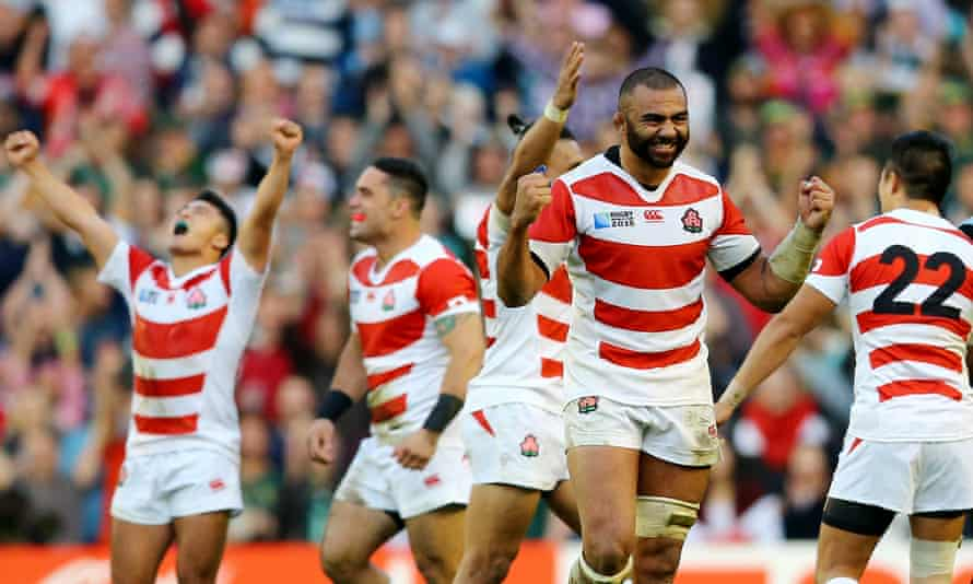 Japan captain Michael Leitch (second right) celebrates after their spectacular 34-32 victory over South Africa in the 2015 World Cup.