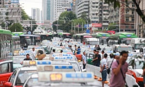 Taxi drivers blocking the streets of downtown Wuhan, Hubei province during rush-hour in a protest against car-hailing apps such as Uber and Didi Kuaidi.