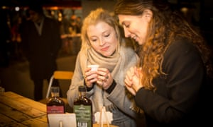 Visitors to the mindful drinking festival sample some of the wares.