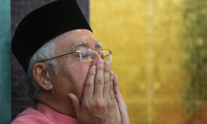 Najib Razak at a party meeting on Friday. He said he was planning a 'short break'