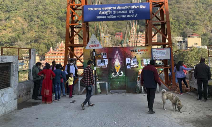 Lakshman Jhula, a suspension bridge across the River Ganges is closed as a precautionary measure in Rishikesh, India, after a portion of Nanda Devi glacier broke off in the northern state of Uttarakhand.