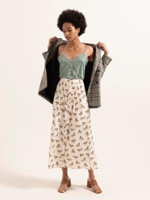 Model wears lace-trimmed camisole, £15.99, pullandbear.com. Skirt, £42, topshop.com. Blazer, £220, whistles.com. Heels, £36, dunelondon.com.