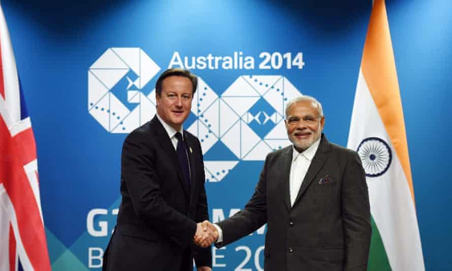 Modi with David Cameron in Australia last year.