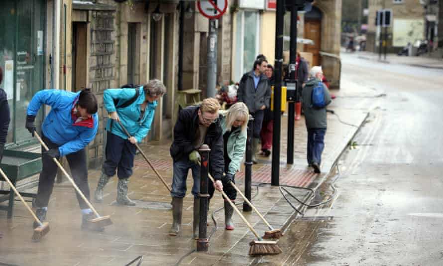 Businesses help with the clean up in Hebden Bridge.