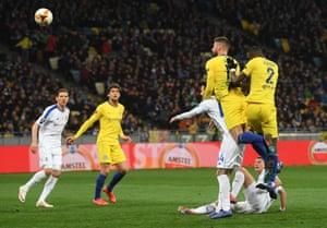 Giroud heads at goal.