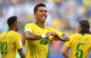 Roberto Firmino of Brazil celebrates after scoring his team's second goal