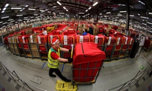 Festive parcels are moved at the Glasgow Mail Centre in Springburn.