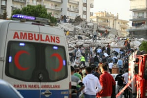 Wounded people are cut free from the wreckage in the Bayraklı district of İzmir