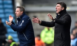 Watford manager Walter Mazzarri (right) alongside Millwall's Neil Harris on the touchline.