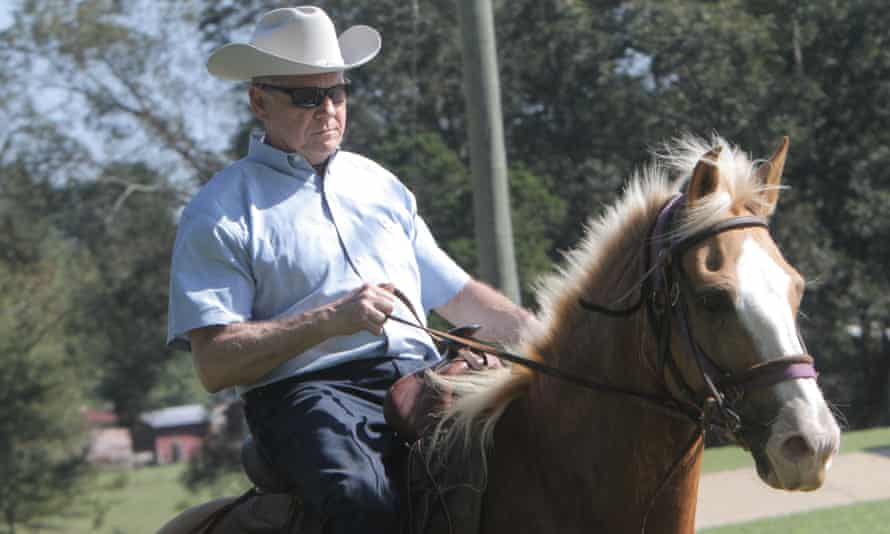 Roy Moore leaves his polling place on a horse.
