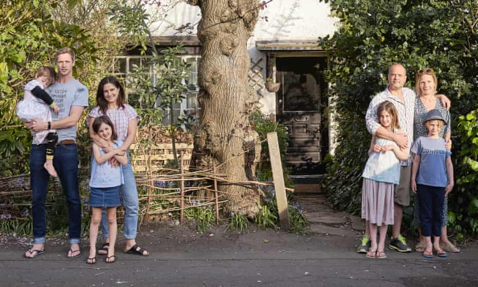 Rob and family, and Barny and family, outside their homes in Kingsmead Road, south London.