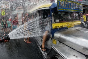San Juan, Philippines: People riding in a jeepney are doused with water during the Wattah-Wattah festival celebrated on Saint John the Baptist's feast day