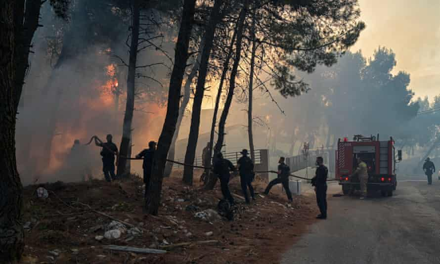 Battling the flames in northern Athens yesterday.