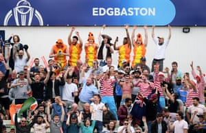 Fans take part in a Mexican wave.