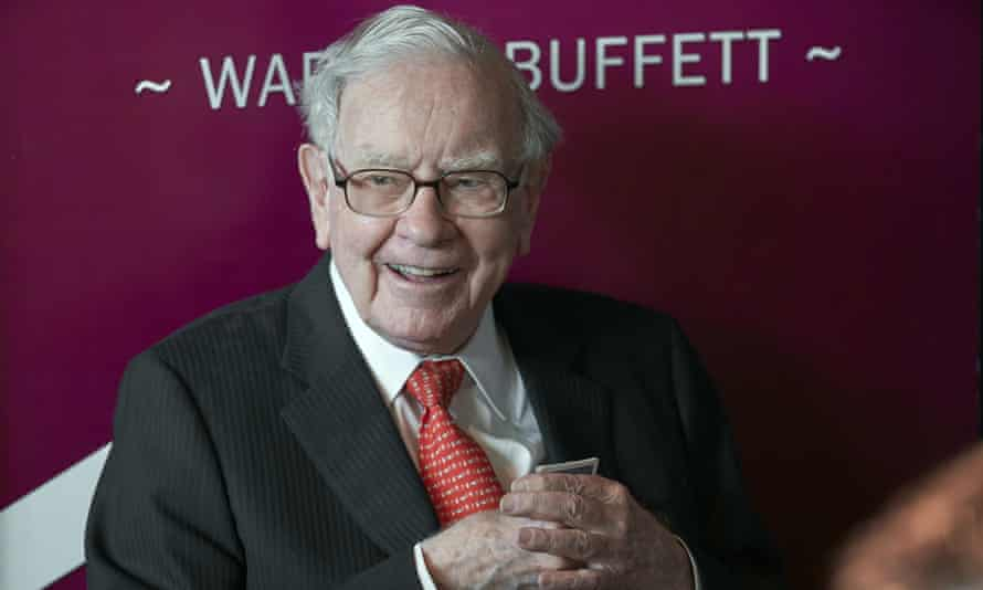 Warren Buffett<br>FILE - In this May 5, 2019, file photo Warren Buffett, Chairman and CEO of Berkshire Hathaway, smiles as he plays bridge following the annual Berkshire Hathaway shareholders meeting in Omaha, Neb. Warren Buffett made a $4.1 billion annual philanthropic contribution and said he's halfway through his goal of giving away most of his money. The billionaire investor also said he is stepping down as trustee of the Bill and Melinda Gates Foundation as he exits all other corporate boards. (AP Photo/Nati Harnik, File)