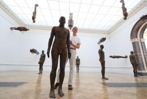 London, UK: British sculptor Antony Gormley poses with his installation of 24 figures, Lost Horizon I (2008)