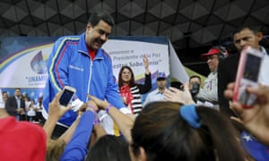 Nicolás Maduro greets supporters during a meeting with the National Union of Women in Caracas on Thursday.