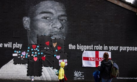 Passersby attach messages of support for Marcus Rashford after a mural of him in Manchester was defaced.