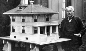 Thomas Edison stands by a model of his prototypical all-concrete house in 1910.