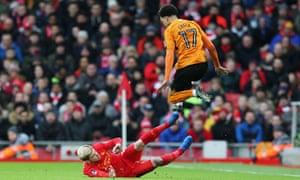 Helder Costa leaps to evade the challenge of Liverpool's Alberto Moreno.